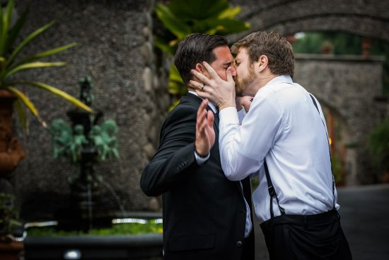 Groomsman Kisses Groom Costa Rica Wedding