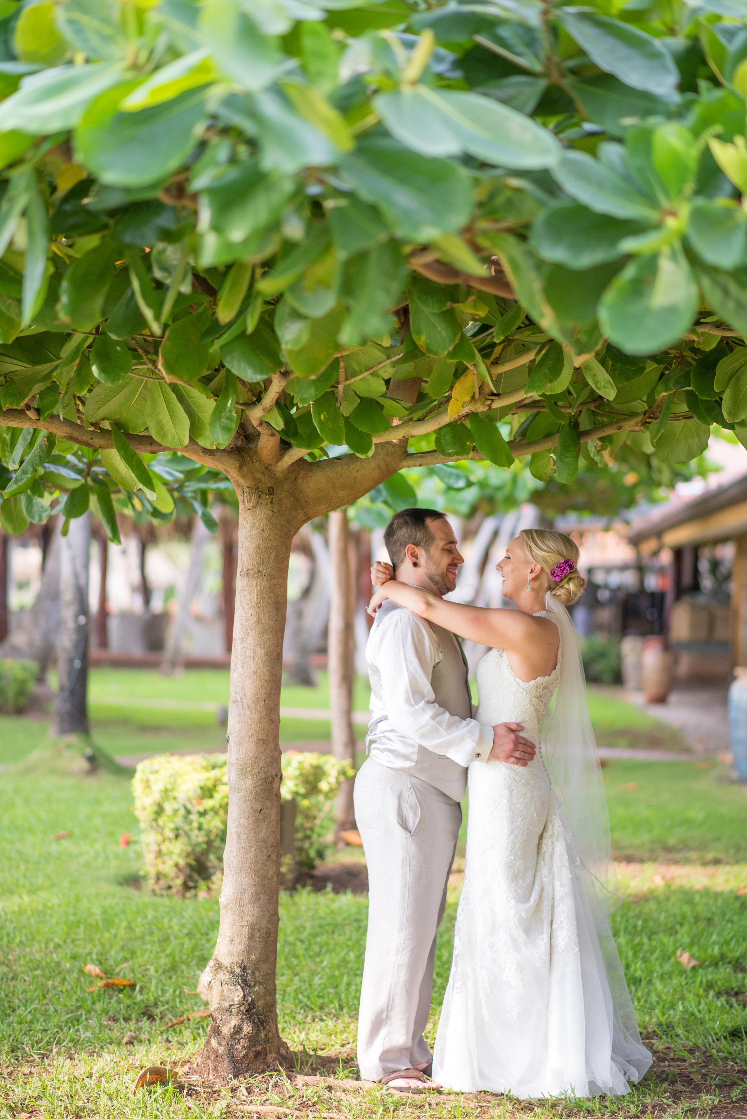 couple kissing first looks under the trees