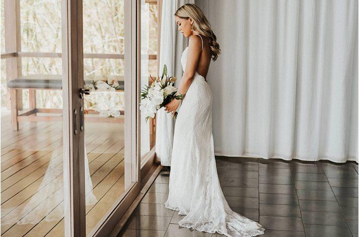 bride looking out the villa Casa Puros Dieces