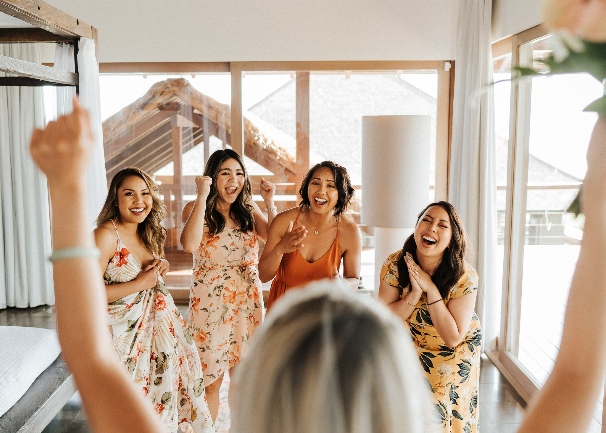 bridesmaids seeing the gown for the first time