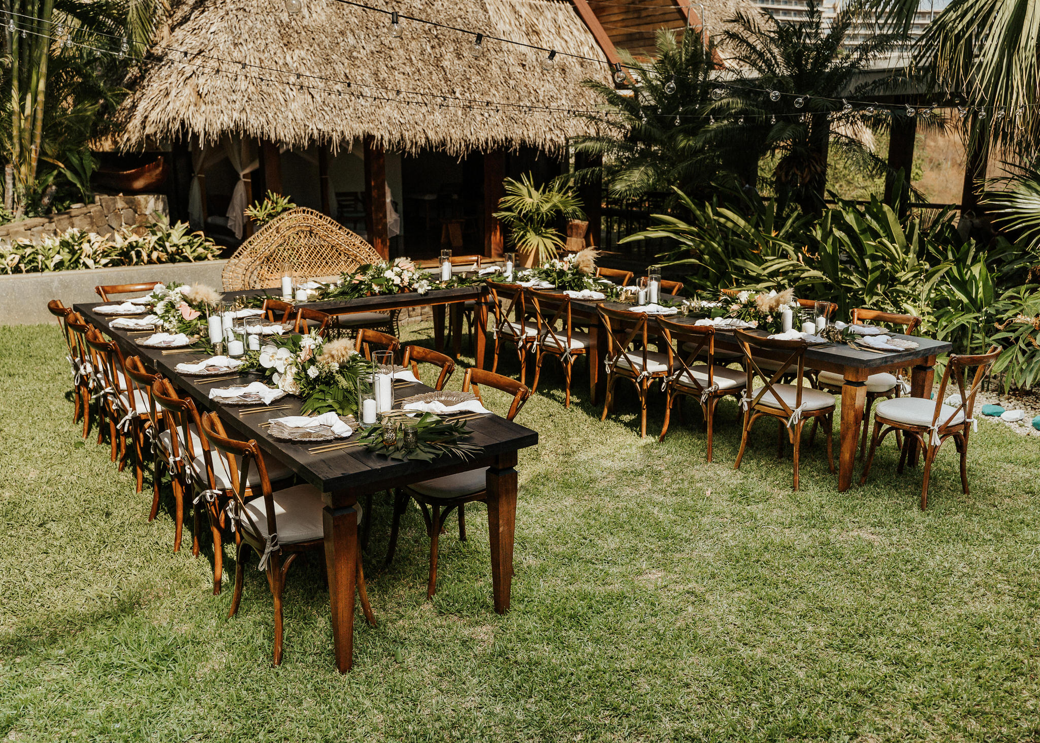 outdoor set up greenery palms table