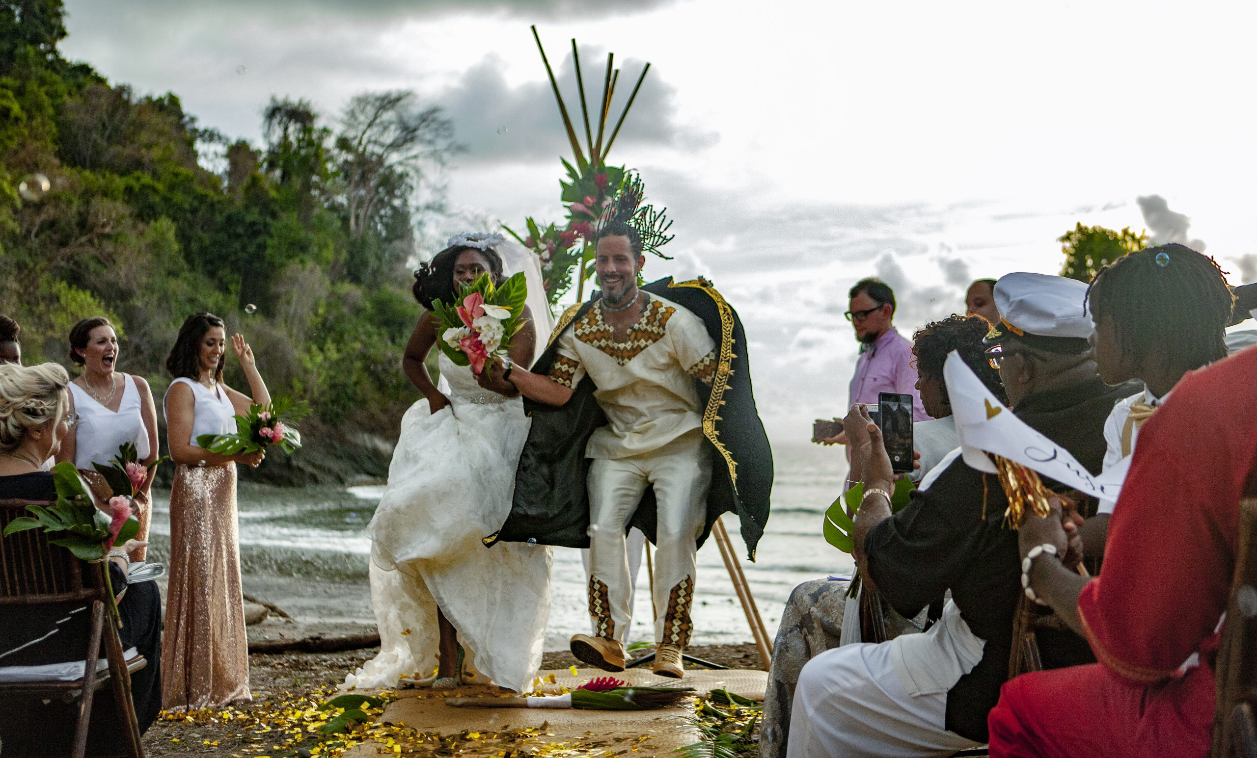 African tradition of jumping over broom stick in african wedding attire