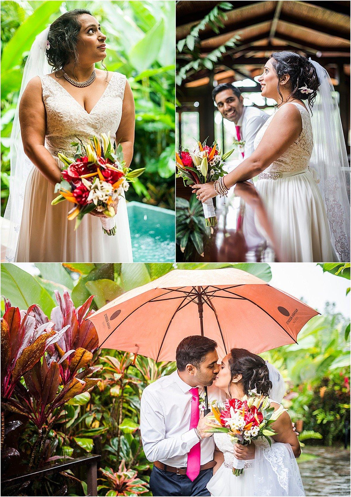 happy couple in the rain under an umbrella