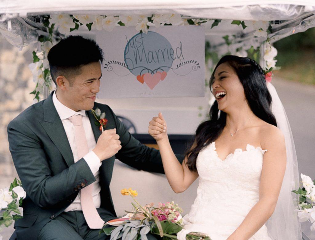 rain wedding fist bump